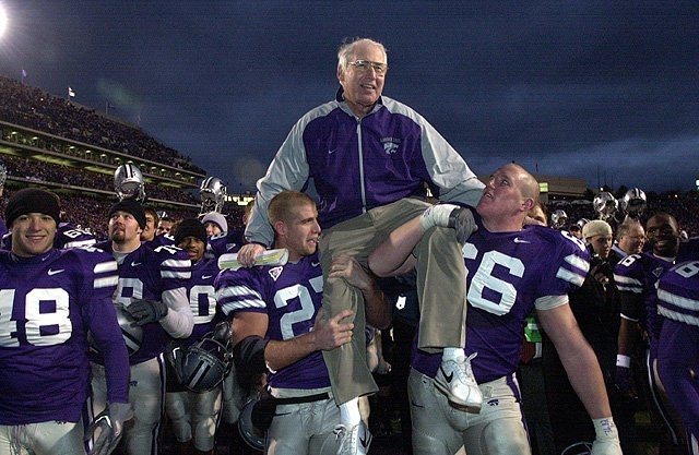 Bill Snyder being carried off the field.
