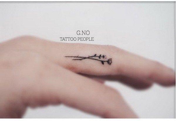 Tiny Flower Tattoo Inside of Finger.