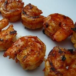 Shrimp marinated in lemon juice, garlic, Italian seasoning, olive oil, dried basil, and brown sugar, then grilled.
