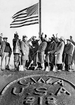 Men employed by the Civil Works Administration cheered as the U.S. flag was lowered at the close of their work day in Chicago In January 1934.