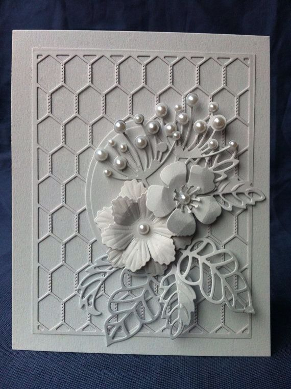 Simple background die with oval & lots of floral/leaf die embellishments