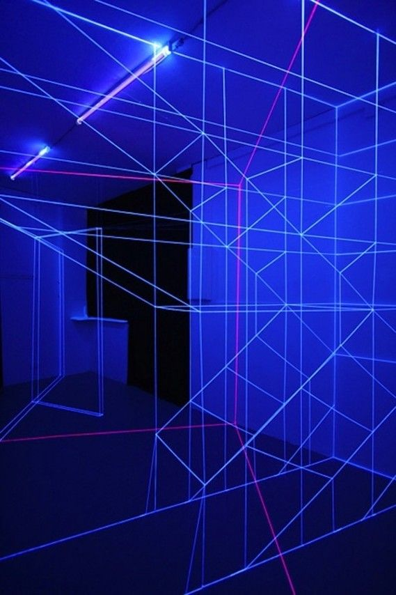 """Jeongmoon Choi, """"Dialogue Lineaire"""", 2013, an installation of woven string illuminated by UV tubes."""