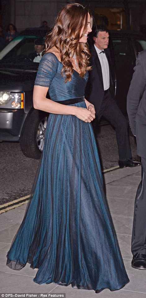 Stunning: The Duchess wore a dramatic floor-length blue and black gown