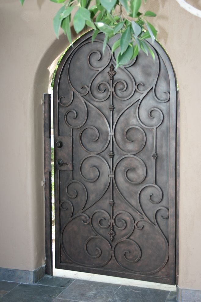 Solid metal gate with curled ironwork detail this reminds for Door gate design
