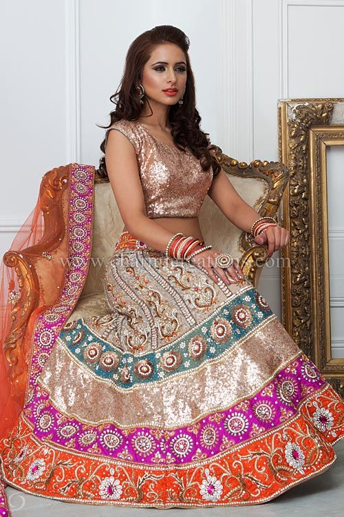 Vintage Wedding Dresses - A colourful lengha with 4 multi-coloured borders, on a brocade silk along with gold sequenced blouse