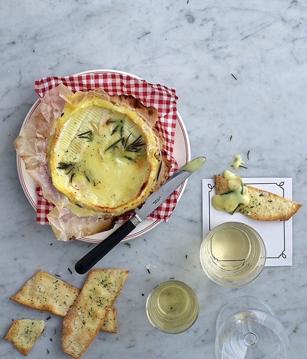 Baked cheese with rosemary and poppyseed crackers recipe | Gourmet Traveller…