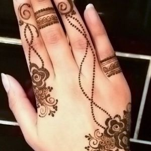 A simple and delicate henna design with roses and spirals