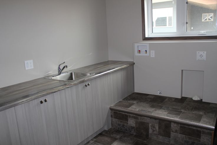 Laundry Room with utility sink, folding counter, and washer & dryer pedestal #laundry