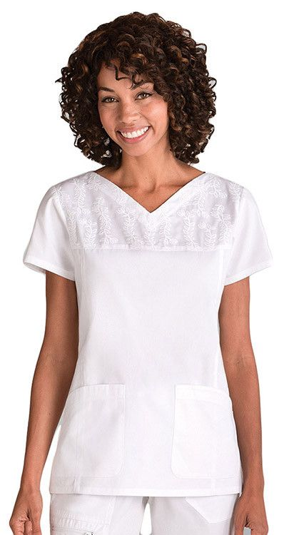 Loving that wide V-neck, and the embroidery at the top is too cute. #ScrubTop #White.