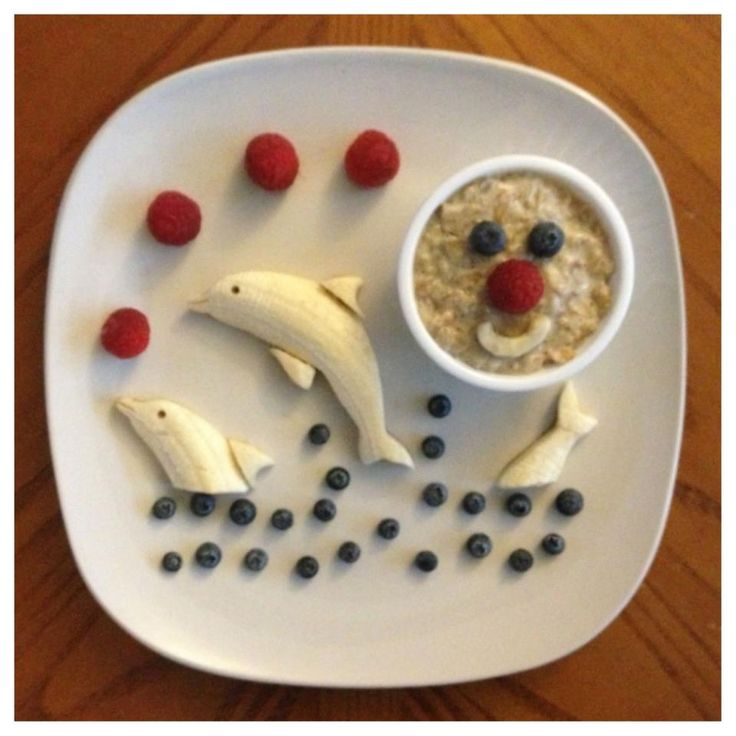 "Dolphins playing in a sea of blueberries (this site has tons of cute ideas for edible fruit ""art."""