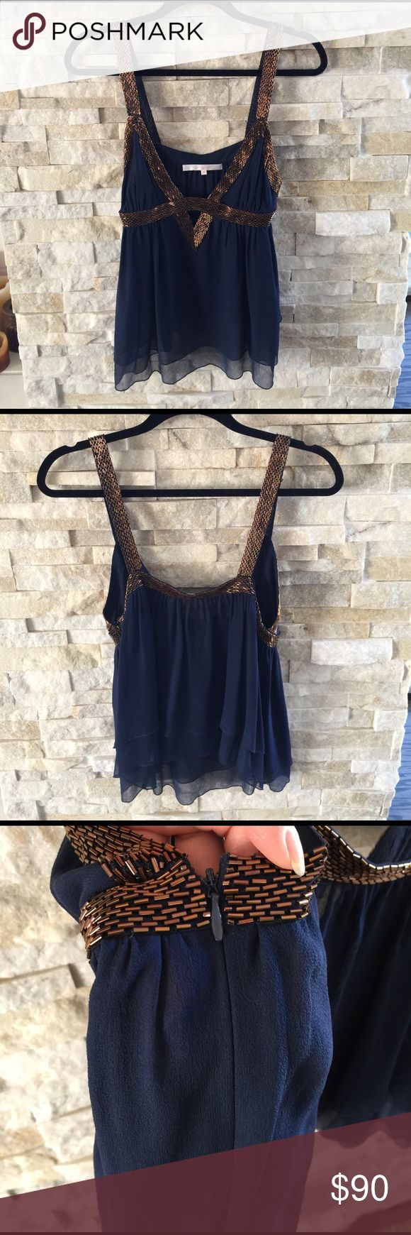 """Jenny Han Navy And gold Cami Navy 100% silk top with gold beading detail on straps and along the bust.  Double layered and tiered silk creates a super delicate effect. This top is gorgeous and I have held onto it and still LOVE it.  Measures 27"""" from shoulder to bottom hem.  Size M fits a size 4/6. Worn once! Jenny Han Tops Camisoles"""