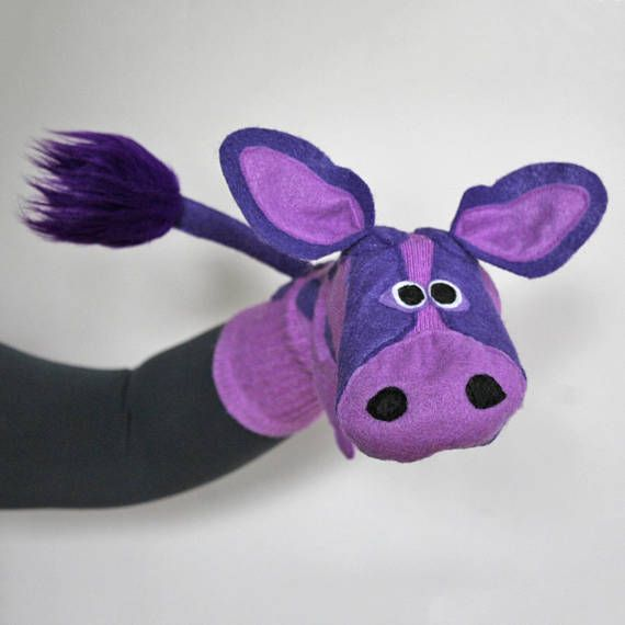 LILY the Cow is practically perfect in purple! She is constructed on a super soft, classic American cotton base (knit exclusively for Socketts) and detailed with gloriously green ecospun felt. In addition to a fun fur-tipped tail and felt udders, this delightful cow sock puppet has a soft