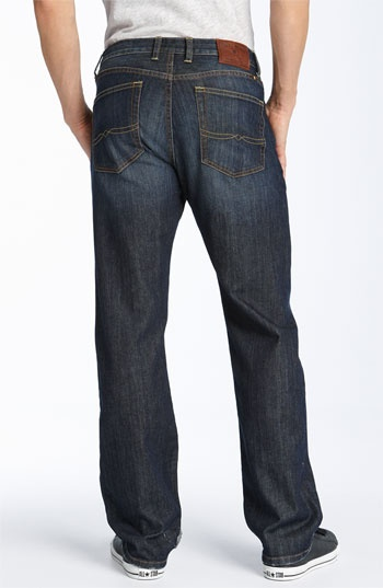 My husband despises skinny jeans on men. This jean is loose on the thighs and not too tapered at the bottom. It is a dark rinse that is a bit faded. It's always good to have dark pair of jeans in your wardrobe.