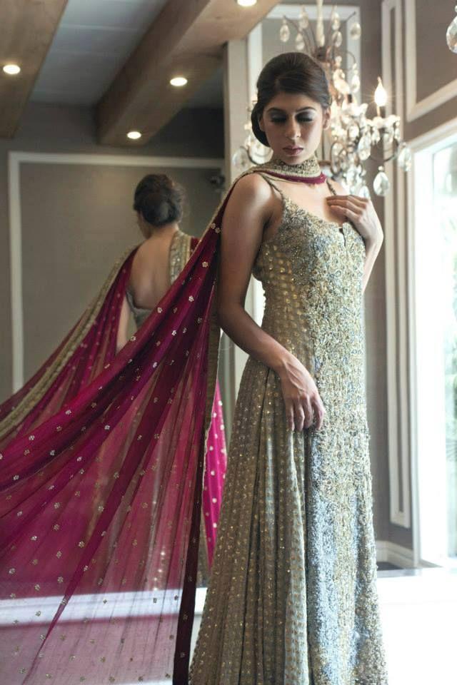 Gorgeous light blue and gold sleeveless anarkali with dark pink dupatta
