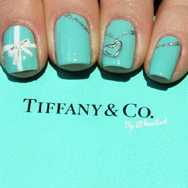 Tiffany Co. nails- Like the white bow for ring finger