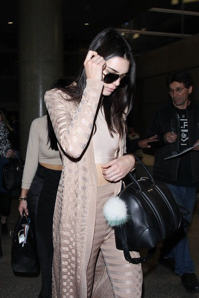 Kendall Jenner Photos - Kendall Jenner and Kylie Jenner at LAX - Zimbio