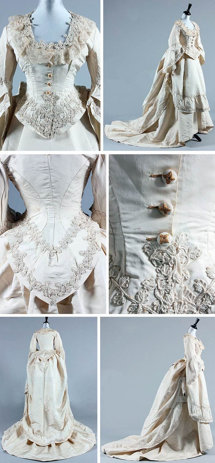 Circa 1871 Wedding gown, Grand Magasins de la Paix. Ivory silk faille with Brussels lace and ivory cord Passementerie. Jacket-like bodice with curved basque and bell-shaped sleeves, skirt, and over skirt. Bustle. Via Kerry Taylor Auctions/Artfact