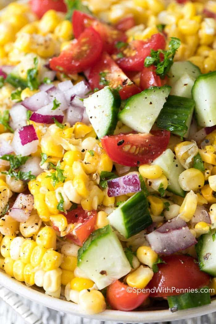 This easy Summer corn salad is one of our favorites! Sweet corn off the cob, crisp cucumbers and ripe juicy garden tomatoes. The corn salad dressing is quick, easy and delicious to make!