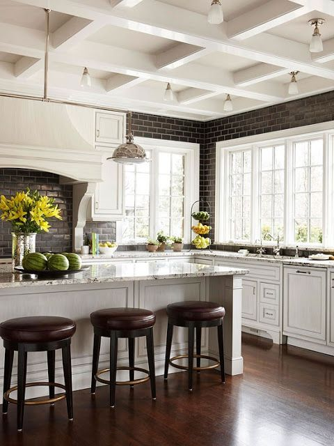 Love the white kitchen against the dark floors & backsplash. Totally in love with the coffered ceiling. (South Shore Decorating Blog)