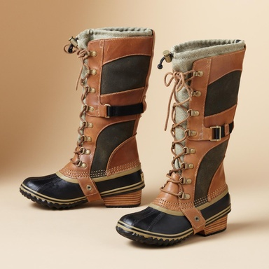 Sorel® Conquest Carly Boots  Sorel®'s iconic all-weather boot in full-grain leather, suede and nylon canvas with a waterproof rubber foot and sole, leather stacked heel. Toggle top snugs in close. Imported
