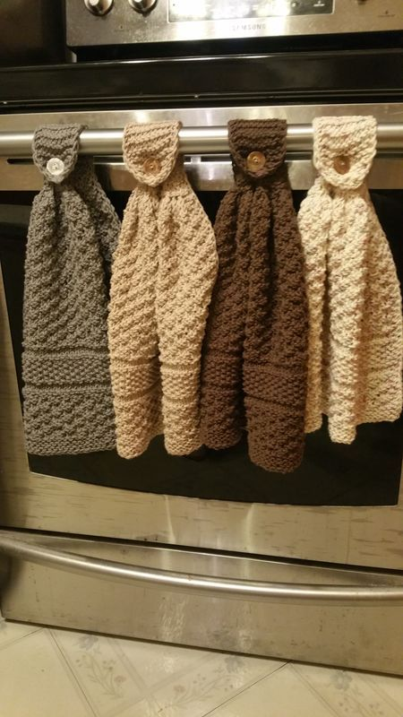Knitted hanging kitchen towels Here is the recipe. I would recommend reading the whole thing first to see if it makes sense to you. Knit hanging kitchen towels Because I like the look of the edging, I crochet cast on and always slip the first stitch with yarn in back, as if I'm purling the stitch, and always purl the last stitch. Side borders are slip 1, knit 2 at beginning and end with knit 2, purl 1. I used Sugar and cream just over one ball with size 7(US) needles. Cast on