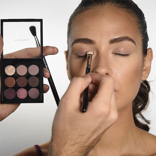 Choose an eyeshadow color that's close to your skin tone and apply it to your lid.