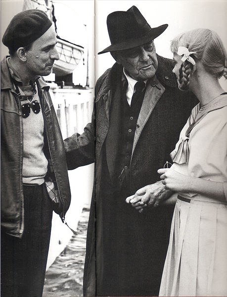 "Ingmar Bergman and actor Victor Sjöström speaks with Bergman's daughter Lena during production of Bergman's 1957 movie ""Wild Strawberries"" at Filmstaden in Råsunda outside Stockholm. Photo courtesy of Pressens Bild, 1957 Swedish press photos more than 50 years old are public domain."