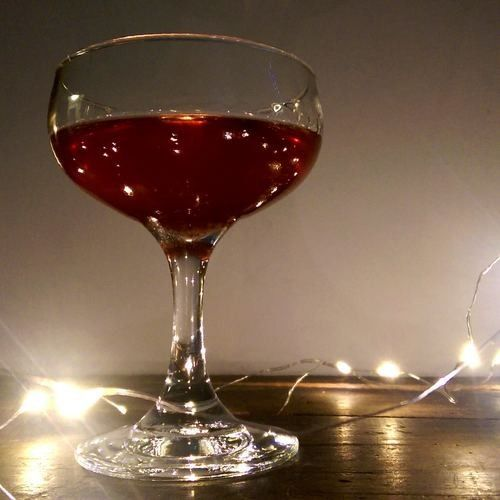I have a bottle of Crème de Cassis gathering dust on my bar. It sits there begging me to forgive it for past crimes against cocktails.