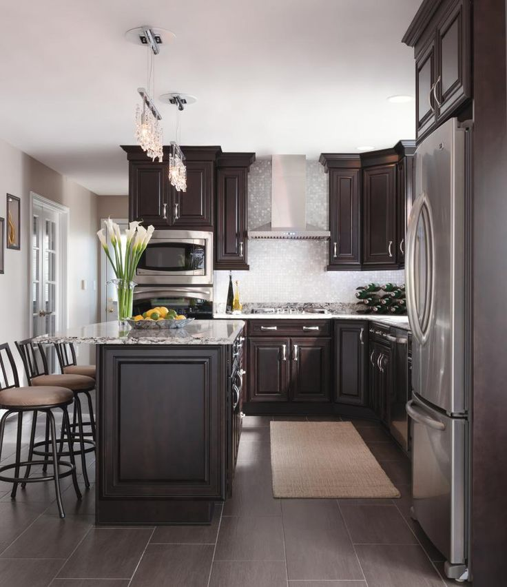 Glamorous touches like a stainless hood and crystal pendants give Kemper's Chocolate finish a luxurious look and feel.