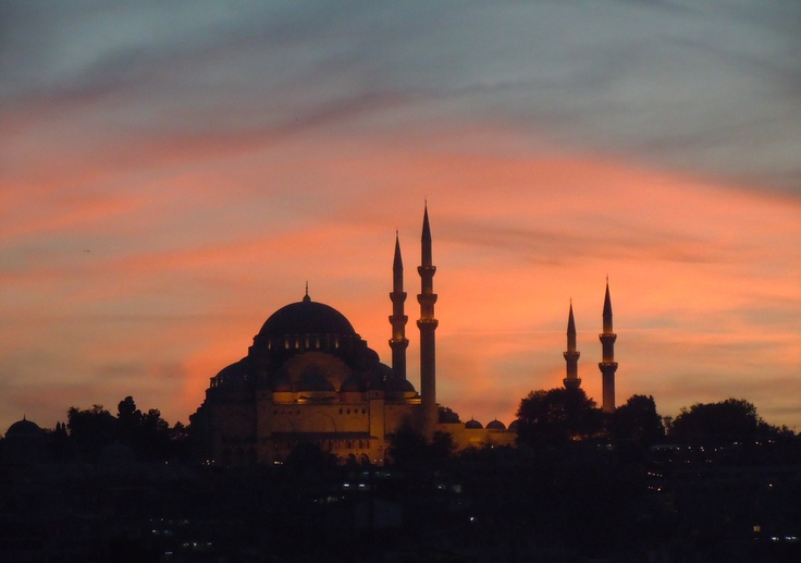 The Süleymaniye Mosque next to the Galata Bridge at sunset.
