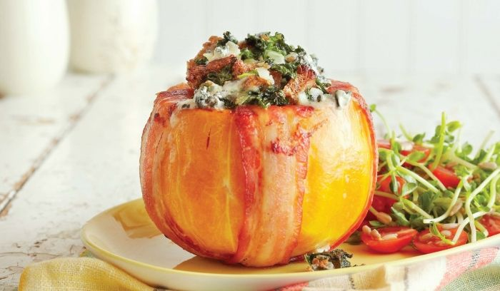 Recipe for Bacon-Wrapped Butternut Stuffed with Kale & Blue Cheese by Taste Canada finalist The Everyday Squash Cook and Rob Firing on Gusto TV.