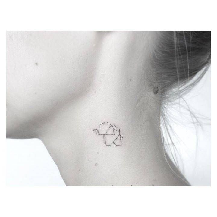 Origami elephant tattoo on the left side of the neck. Tattoo artist: Jakub Nowicz More