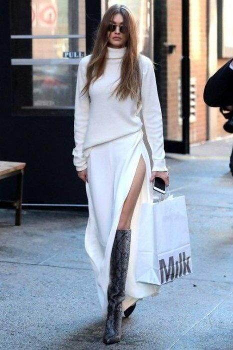 The queen of monochrome, Gigi nails the trend constantly! Here, she dons a white turtle neck sweater with a maxi skirt with a high slit.