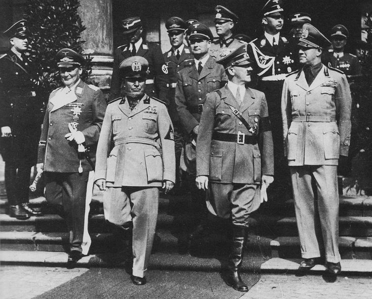 Munich Agreement, 1938. Goering, Mussolini, and Hitler lead the pack. Himmler, Hess, and Keitel in the back rows. Under the agreement, Britain, France, Germany, and Italy signed off on the German annexation of portions of Czechoslovakia known as the Sudetenland. Czechoslovakia was not invited. The agreement has become synonymous to appeasement.