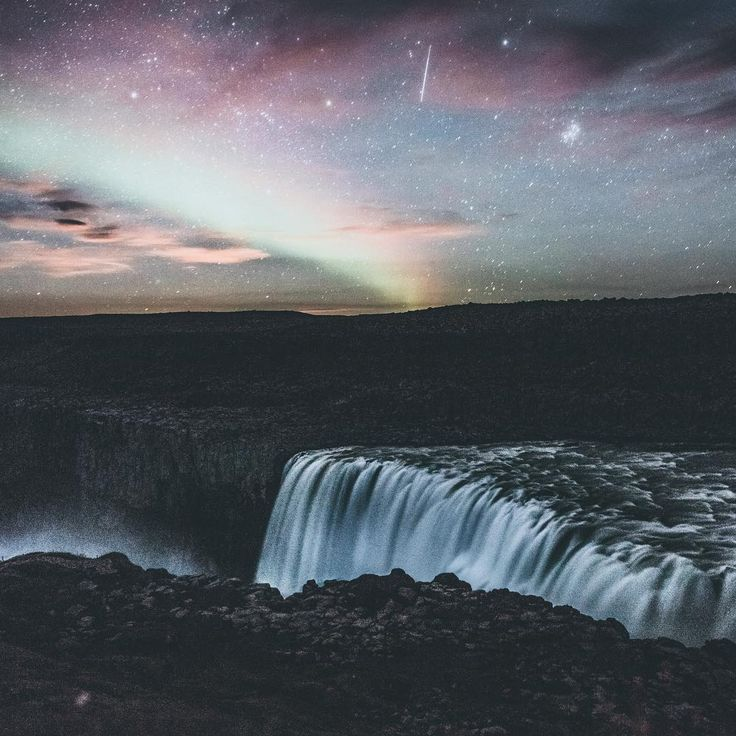 Shooting star, largest waterfall in Europe, the northern lights and the haze from a blood moon rising. this picture is all my favorite things