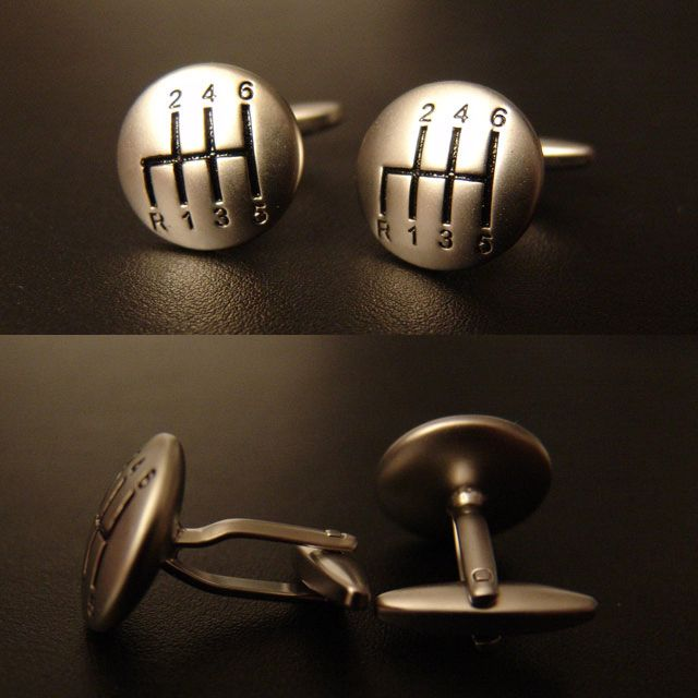 This exclusive pair of gearshifter cuff links is the perfect expression of your style!  This silver gearshifter knob is engraved with a standard manual shift pattern.  Accented in black paint, it stands out great on any color shirt.  The finish is a semi polished metal finish that pairs well with any tuxedo.