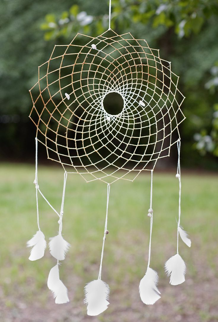 100% Cotton Floating Weave Dreamcatcher with Rose Quartz, Seashell and White Turkey Feather Dream Catcher for a Pure Love. $38.00, via Etsy.