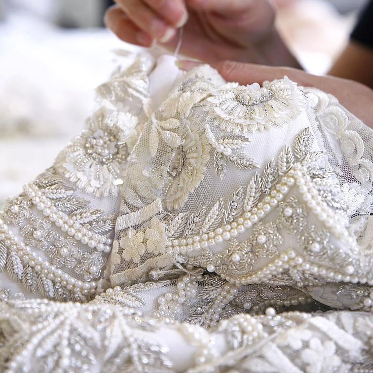 With lustrous pearls and hours of intricate thread-work, our expert couturiers bring Look 5 from the AW15/16 collection to life #ralphandrusso #couture #hautecouture #embroidery #whitedress #pearls #aw15 #autumnwinter #craftsmanship