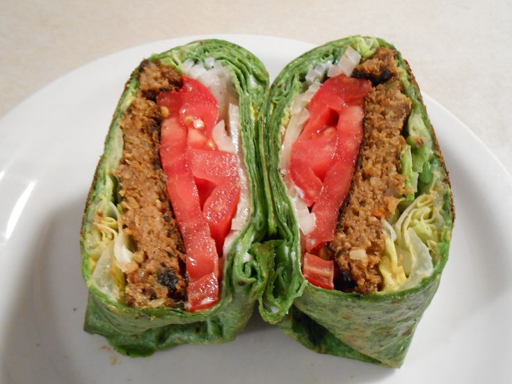 VEGGIE BURGER SPINACH TORTILLA WRAP!  Spinach tortilla wraps take your favorite veggie burger sandwich to a new level! For this one we use lettuce, tomato, onion with veggie mayo and mustard!  Makes 1