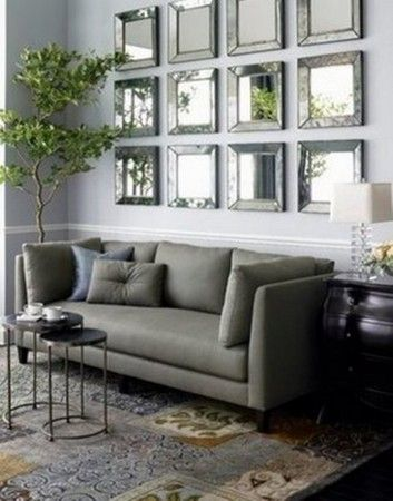 modern squared wall mirrors installed above a sofa