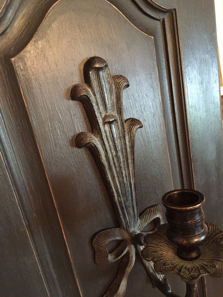 UpCycled Kitchen Cabinet door transformed into a stunning Candle Wall Sconce.