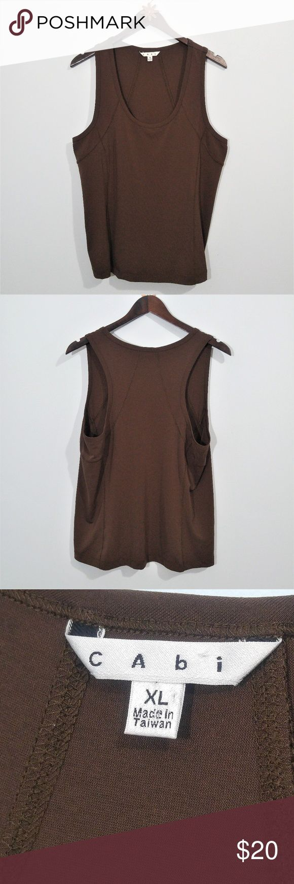 "CAbi #958 Chocolate Brown Luxe Stretch Tank Top XL Very gently pre-loved Cabi 958 brown semi fit and stretchy, sleeveless racerback style tank top. 92% polyester, 8% spandex.  Approx measurements: Underarm to underarm 20"" Length shoulder to bottom hem 25.5""  Same day or next business day shipping. Offers always welcomed & bundles always discounted. ""Like"" my items for private flash sales! Thanks for looking :) CAbi Tops Tank Tops"