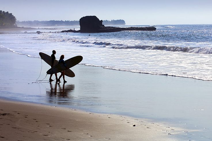 Surf's up at El Tunco, El Salvador, so do the deed and hit the beach. Image by John Coletti / AWL Images / Getty Images.