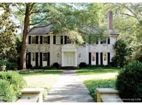 whitewashed brick colonial home.  gorgeous!