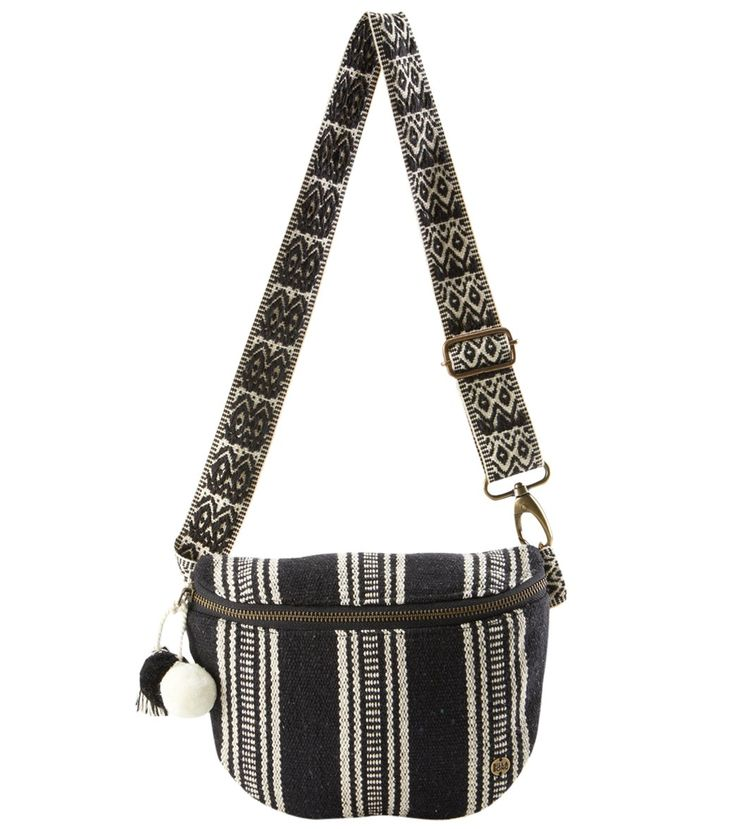 A bag for free spirits and free hands. Made to move with you as your wander, the BillabongMovin On Fanny Pack features a black and white striped fabric, contrasted with a printed belt, and topped with pom pom trim.