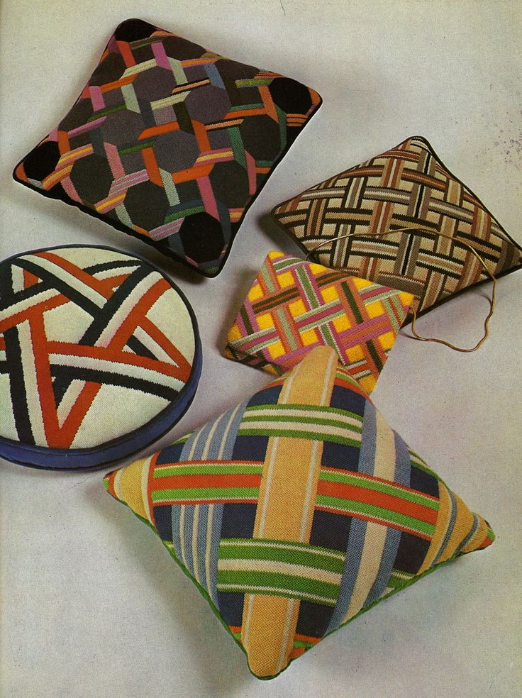 Ribbon designs as needlepoint pillows.