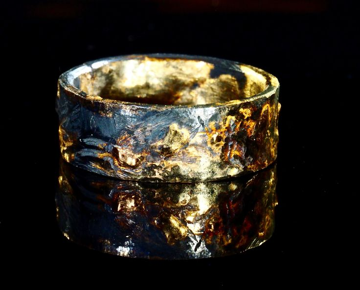 Mens wedding band of 18K gold and oxidized silver. I create these wild patterns with my own process of super heating the two metals to completely fuse them. Mixing 18K yellow, rose and white gold adds