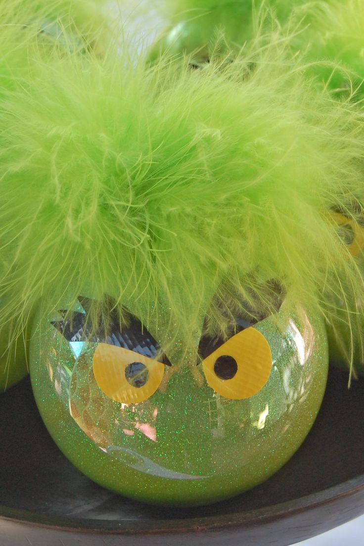 Grinch ornaments (I've made 10 of these): I decorated clear platic ornaments (with kids in mind) inside with Pledge floor wax and Martha Stewart glitter.  Then I hot glued a snippet of green feather boa around the top.  I punched yellow eyeballs with black centers out of duck tape sheets, and then cut out (free hand) eyebrows.  Pretty simple... love the results.