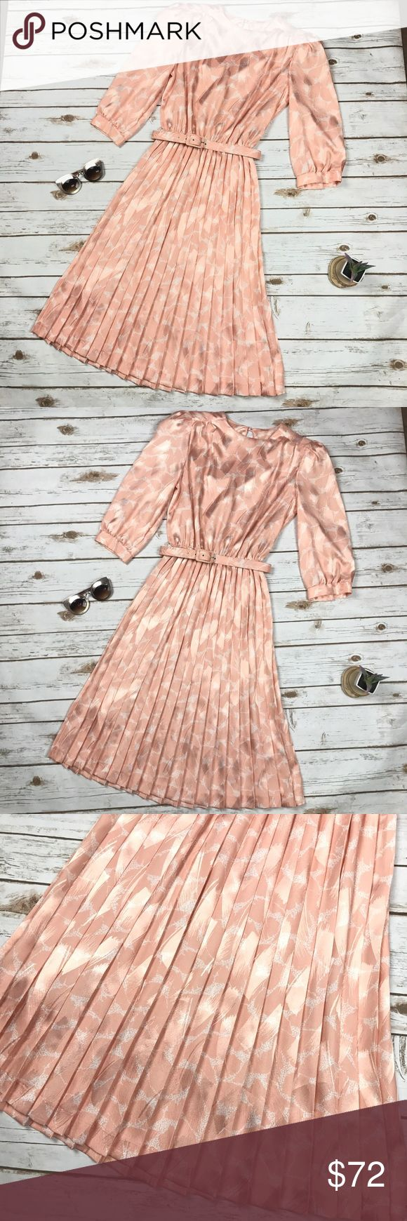 """Vintage Light Pink Belted Pleated Pinup Midi Dress VTG Alexis Petites Light Pink Belted Pleated Pinup Midi A-line Tea Dress 10. Excellent condition, no flaws or signs of wear. Elastic waist with detachable belt, shoulder pads, permanent pleats and 3/4 sleeves. 100% polyester, Made in the USA. Bust- 40"""", Waist- 25""""-30"""", Hip- free, Length- 43"""". Alexis Petites Dresses Midi"""