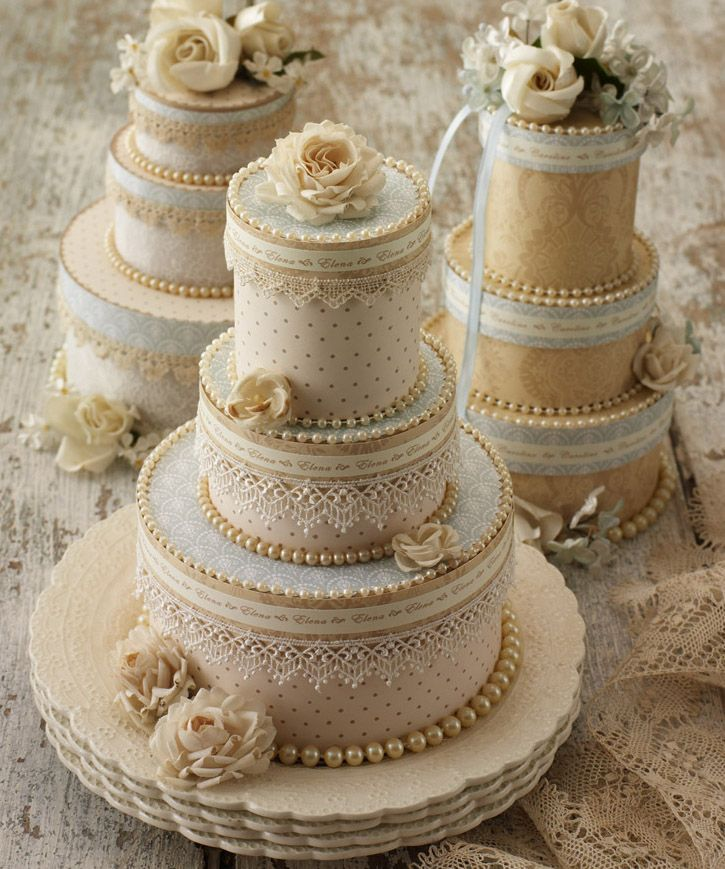 Clever keepsakes mimicking wedding cakes!  Embellish craft paper boxes and fill with treats!